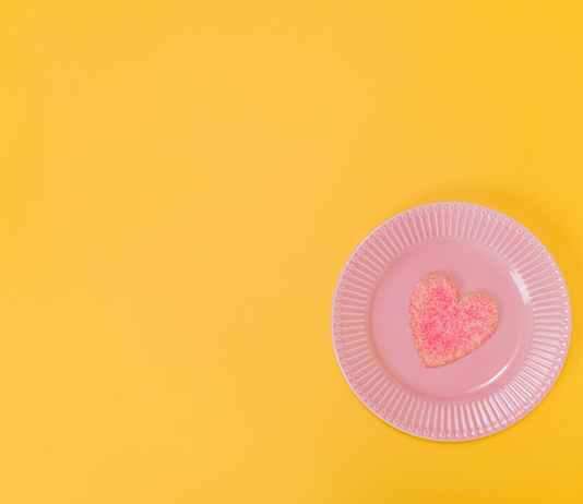 pink heart shaped cake on paper plate