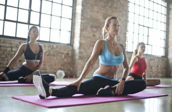 three woman doing an exercises