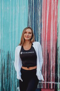 Wellness Tips for The New Year by The Experts, a blog post by Liz in Los Angeles, Los Angeles Lifestyle Blogger, an image of a woman wearing fitness clothes