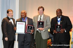 Edward R Carey award winners with District Governor Matt Kinsey DTM