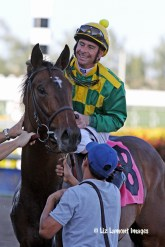 Finnegans Wake (KY) in the winners' circle at Gulfstream Park