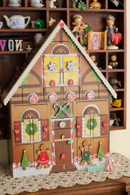 wood Advent Calendar in the shape of a gingerbread house
