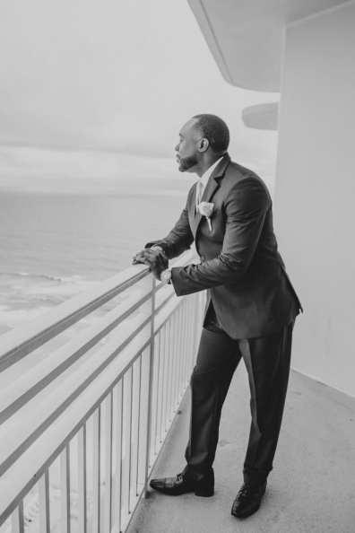 Groom Overlooking The Ocean Black & White