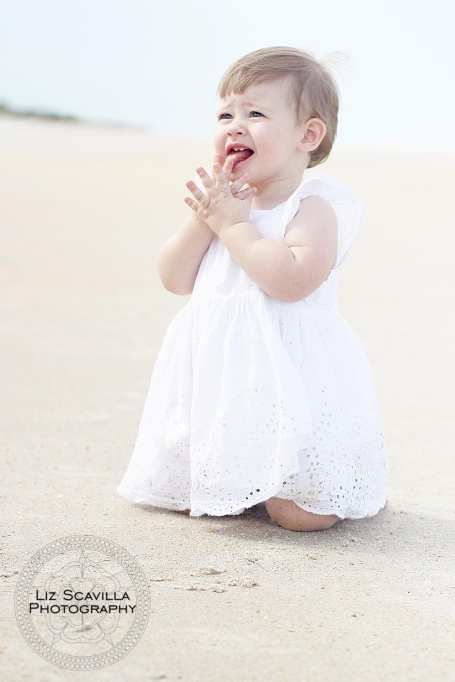 Baby Playing In The Sand