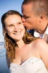 Bride smiling on beach