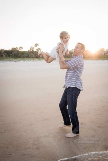 Dad Throwing Little Girl in Air