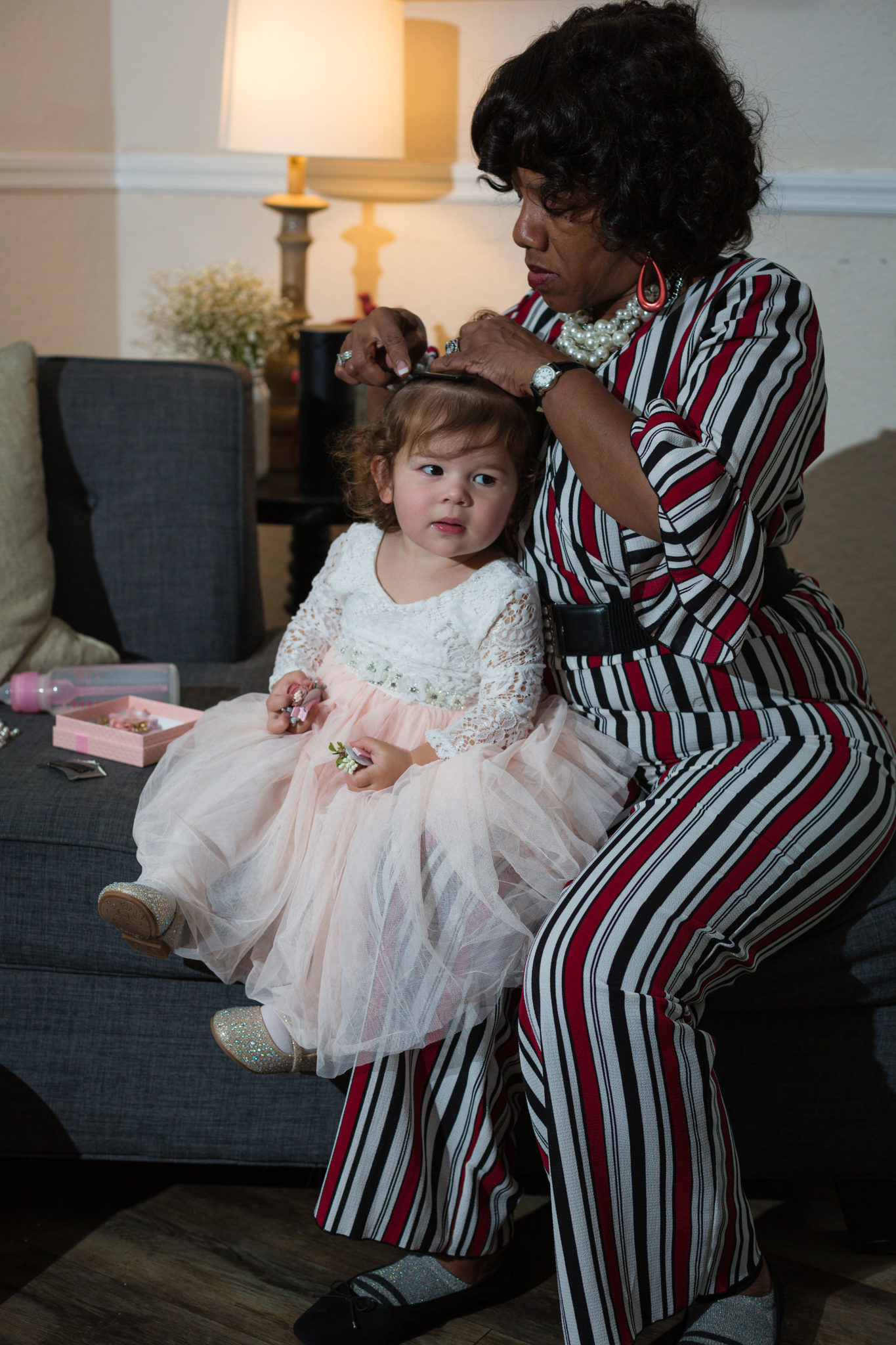 The bride and groom's daughter getting her hair done. So precious!