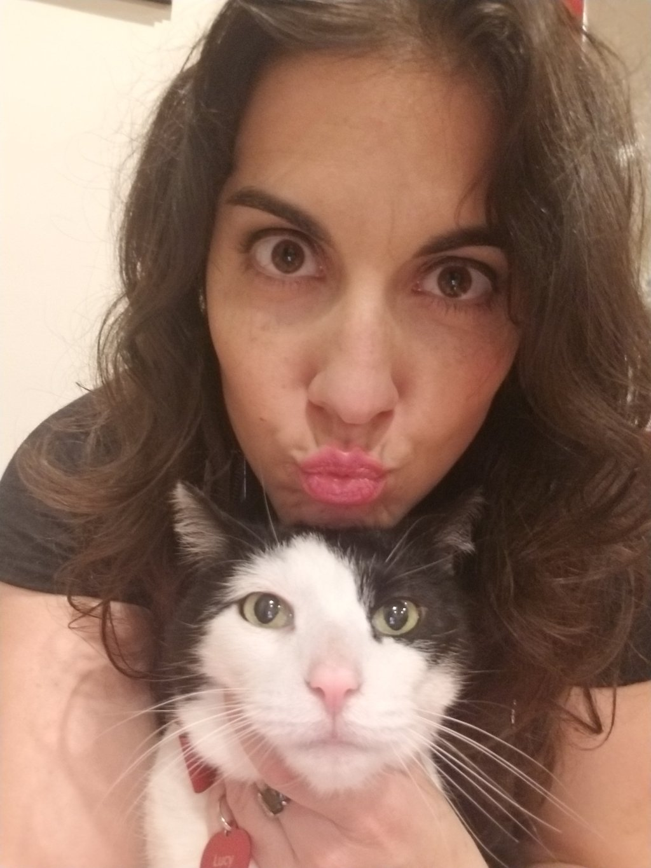 Woman with tuxedo female cat