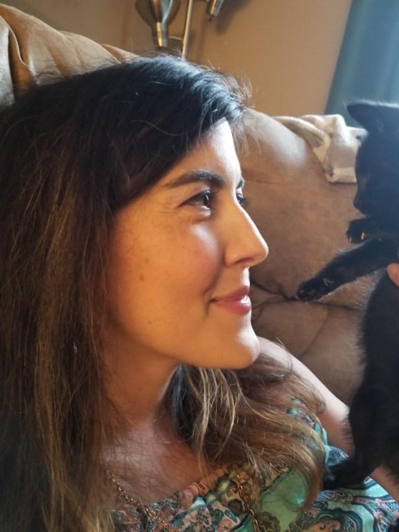 woman with black kitten