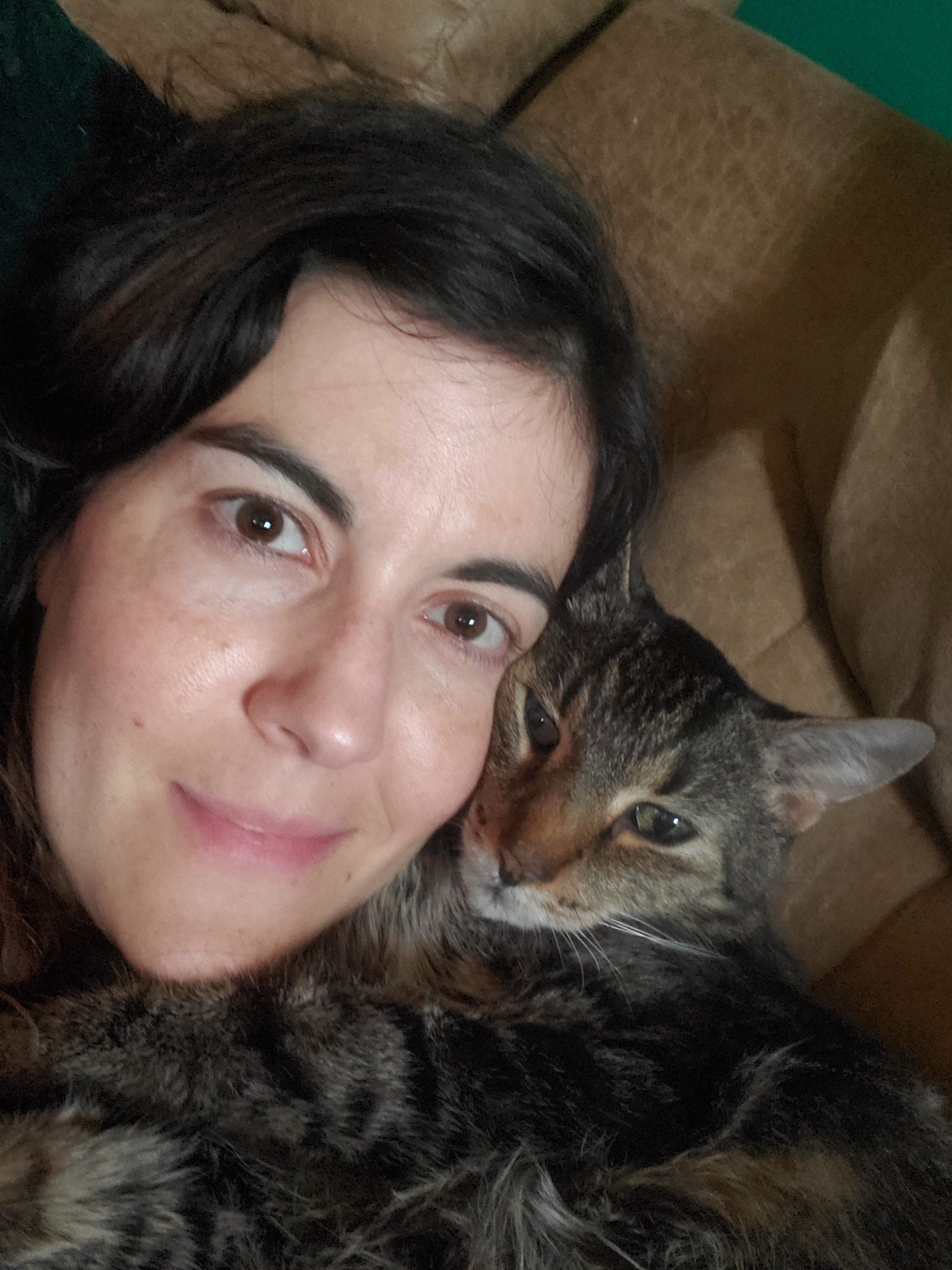 Woman snuggling cat