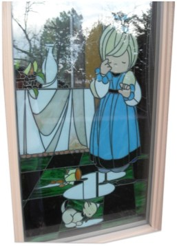 instead of stations of the cross, kitty shenanigans are depicted in the Precious Moments Chapel's stained glass.