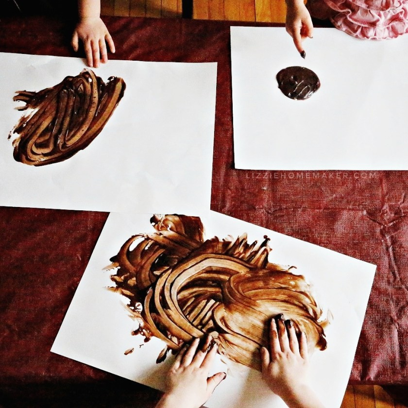 Lizzie Homemaker kids finger painting with chocolate pudding on a rainy day