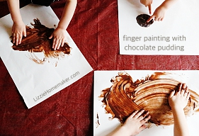 Finger painting with chocolate pudding