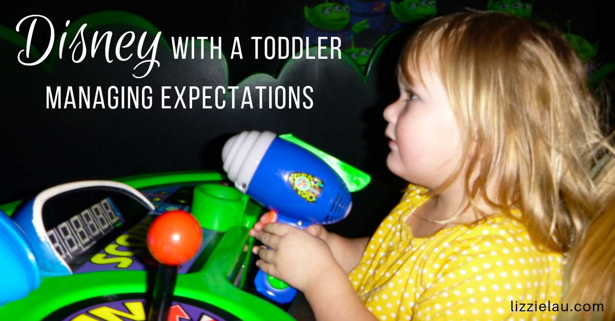 toddler at Disney in the Buzz Lightyear ride