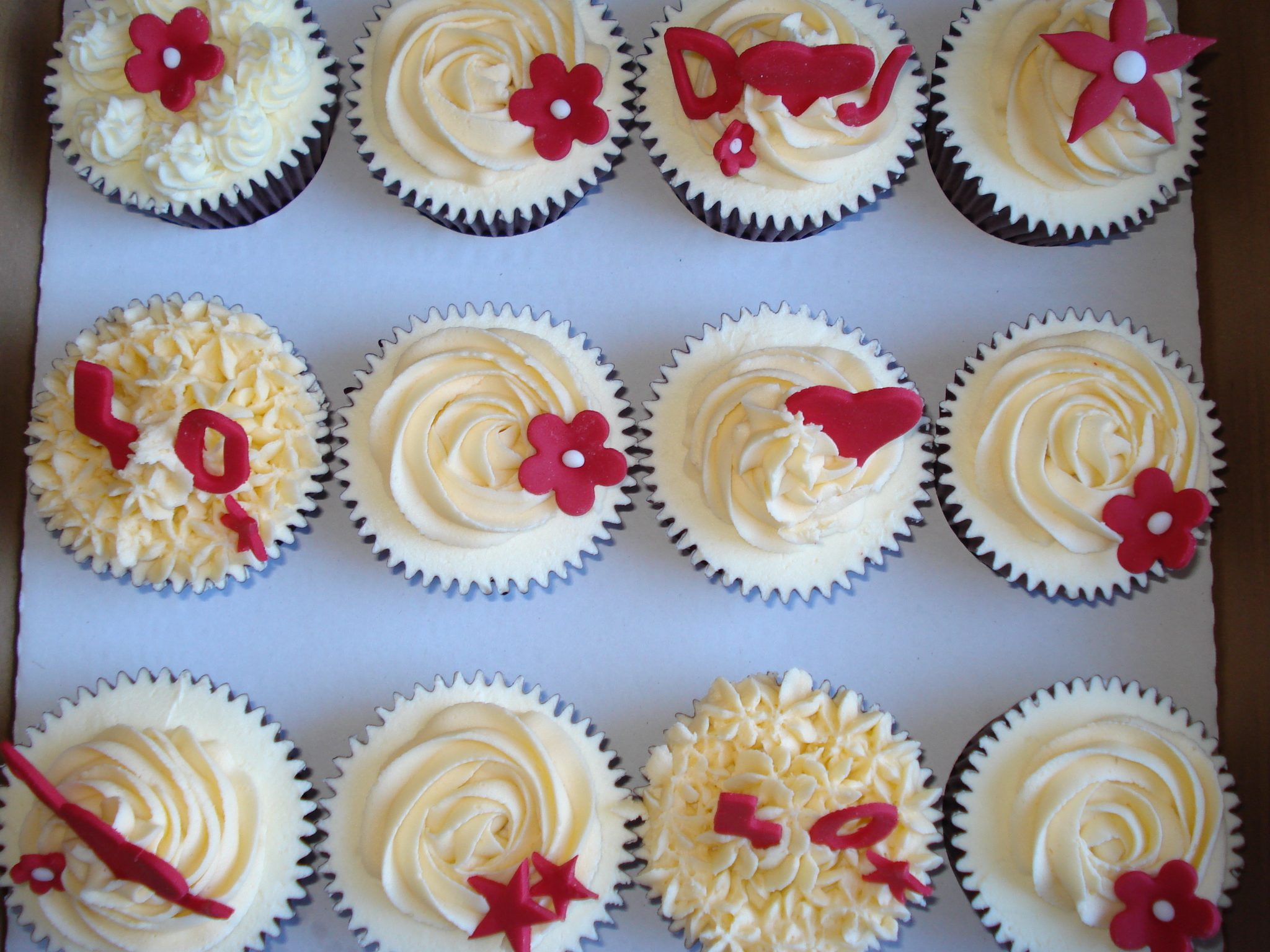A dozen ivory and ruby cupcakes
