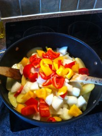 Peppers and onions go in next