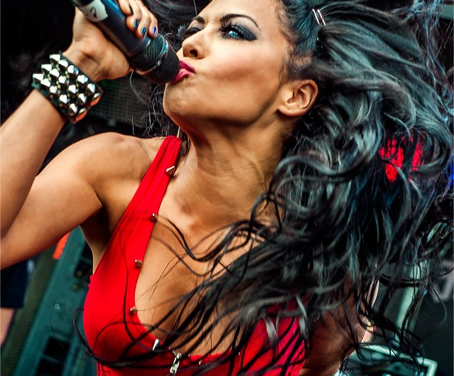 Vocalist Carla Coates of Butcher Babies flinging her hair at Rock on the Range.