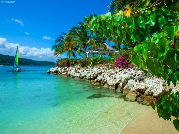 A sailboat and gazebo over beautiful Caribbean waters at Ocho Rios, Jamaica.