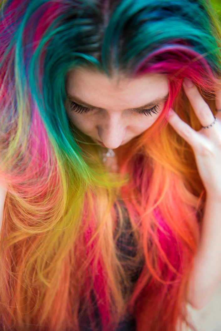 Soft rainbow hair colors on Lizzy Davis.