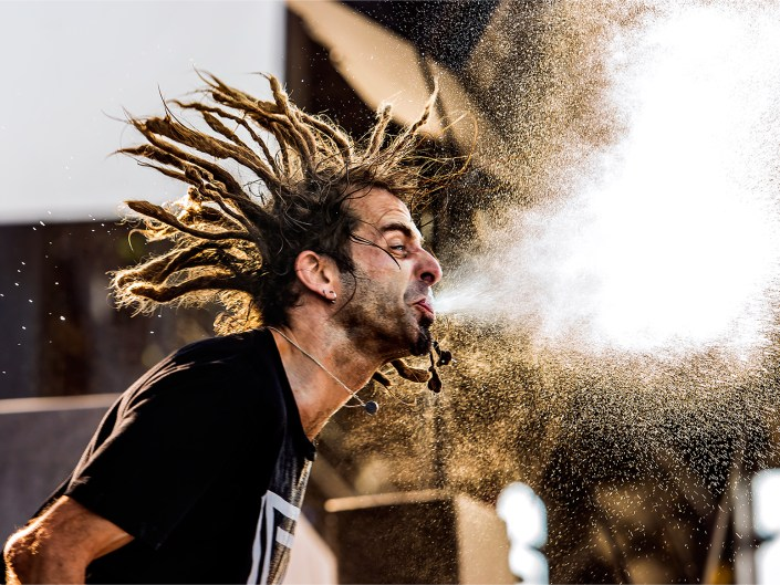 Photo of Lamb of God vocalist Randy Blythe spraying water at Welcome to Rockville.