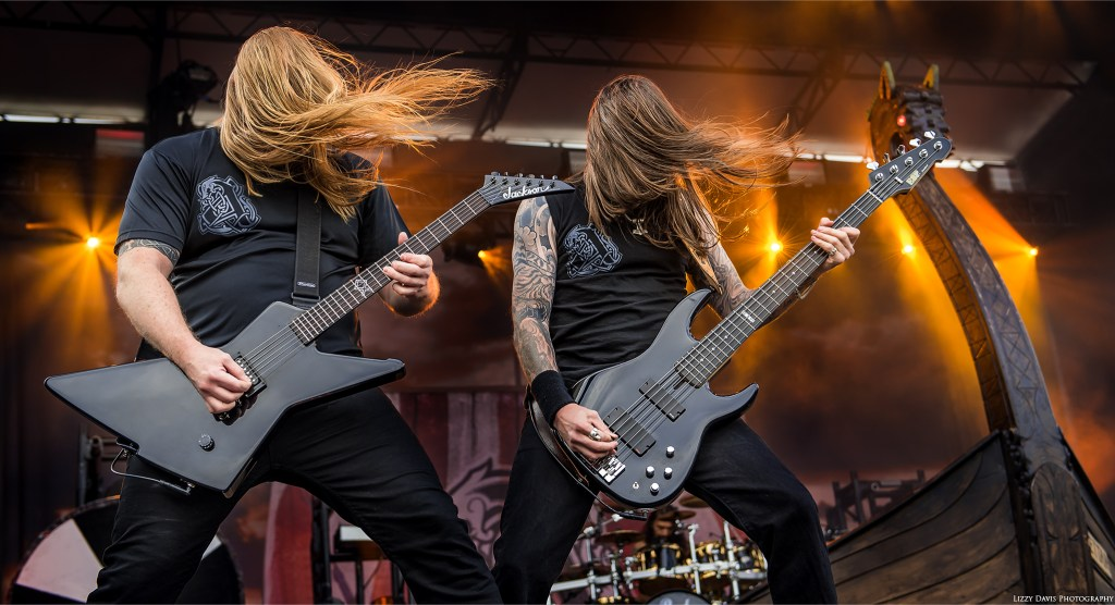 Amon Amarth guitarist Olavi Mikkonen and bassist Ted Lundström headbanging together at Carolina Rebellion.