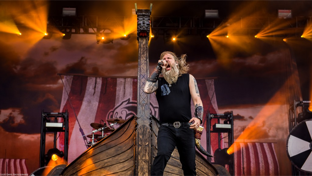 Amon Amarth photo of vocalist Johan Hegg in front of their iconic Viking Ship.
