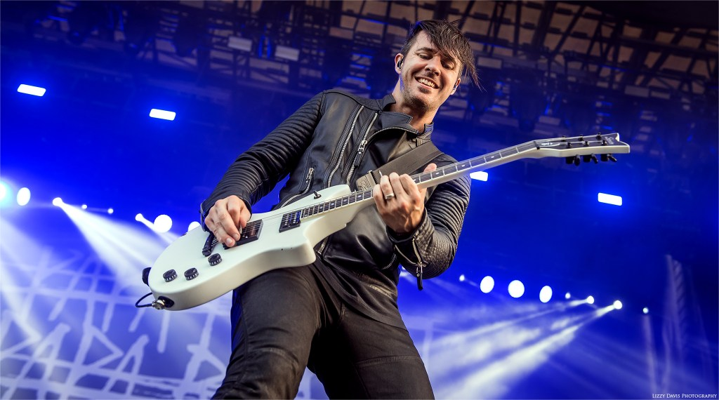Papa Roach guitarist Jerry Horton flashes a smile while playing. ©Lizzy Davis Photography