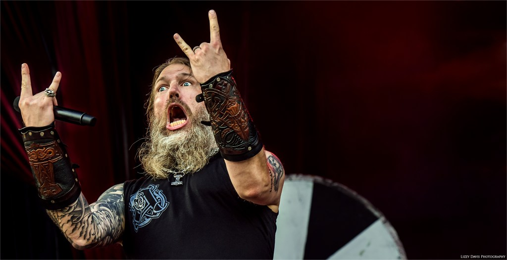 Johan Hegg of Amon Amarth throws up metal horns.