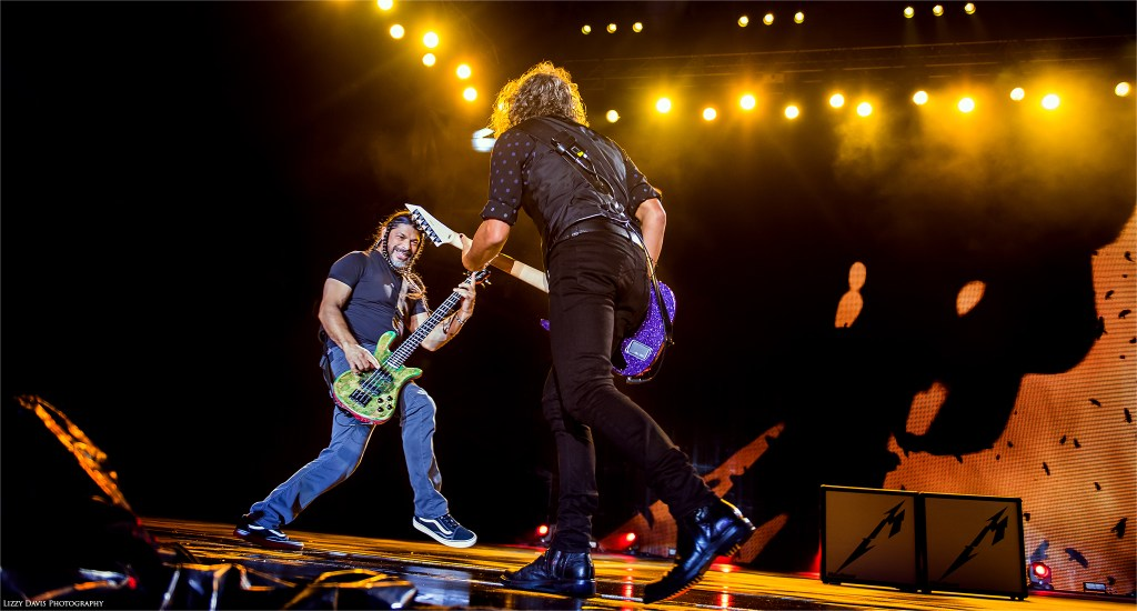 Metallica live 2017. Robert Trujillo and Kirk Hammett sharing a playful moment at Rock on the Range. ©Lizzy Davis Photography