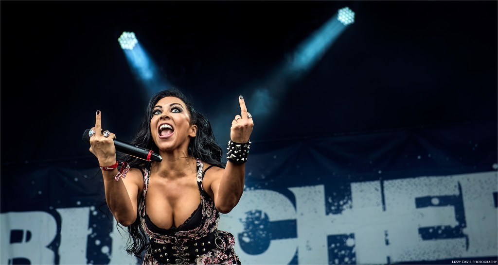 Carla Harvey expressively flips the camera off. Butcher Babies photos by ©Lizzy Davis Photography.