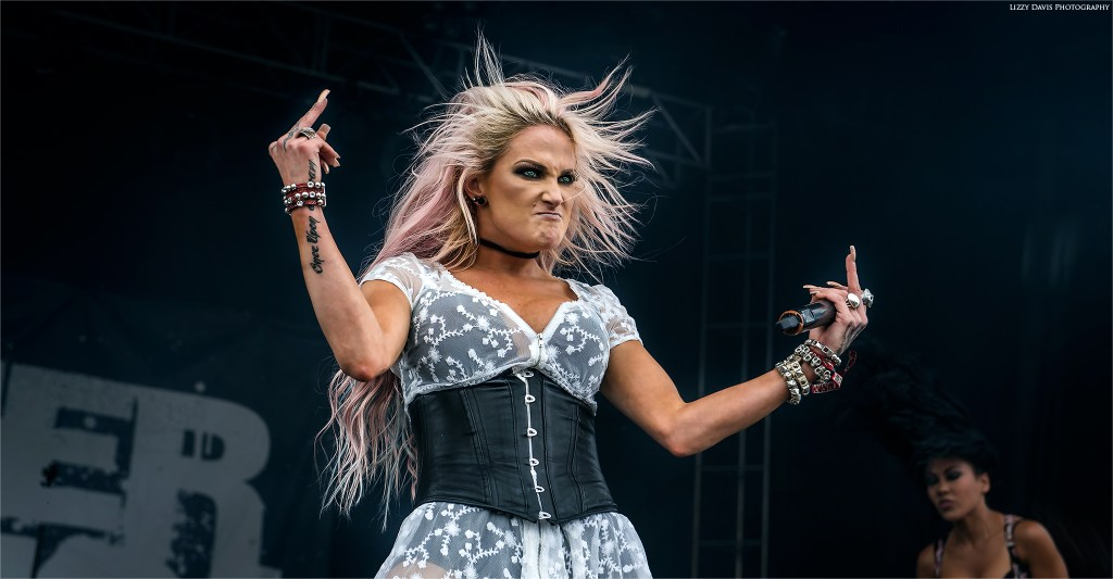 Heidi Shepherd puts her middle fingers up! Butcher Babies photos by ©Lizzy Davis Photography.