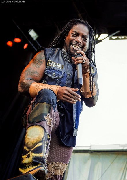 LJ Witherspoon smiling during Sevendust's set at Welcome to Rockville 2016. ©Lizzy Davis Photography