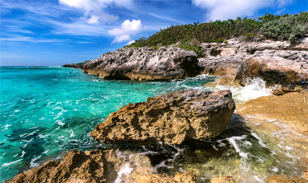 Water splashing up over the rocks at the end of Half Moon Cay beach. Bahamas photos by Trevor Williams.