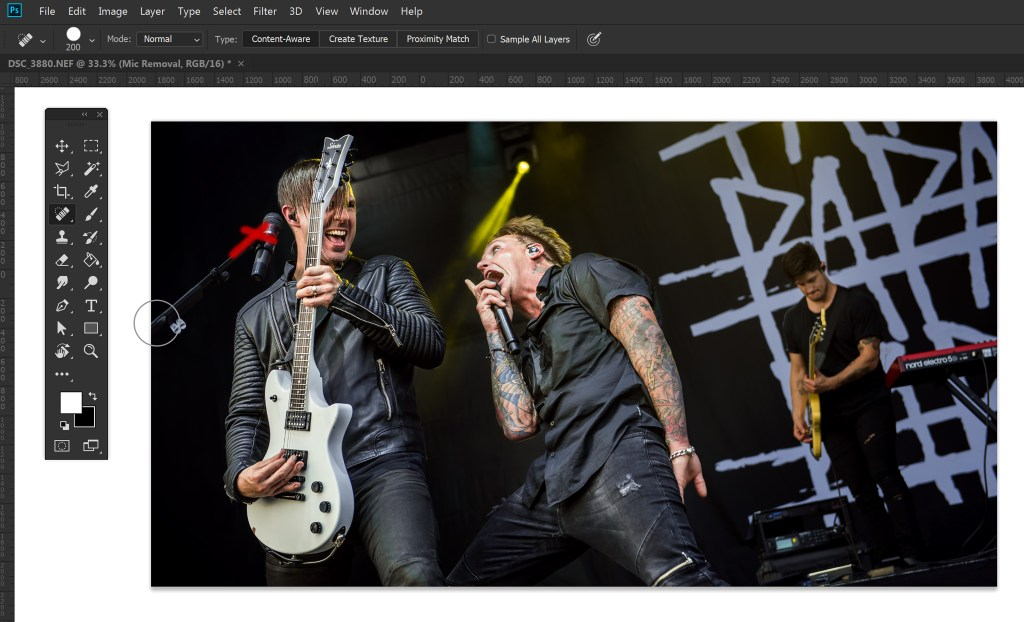 Photoshop for Concert Photographers - Using the spot healing brush to remove mic stands.