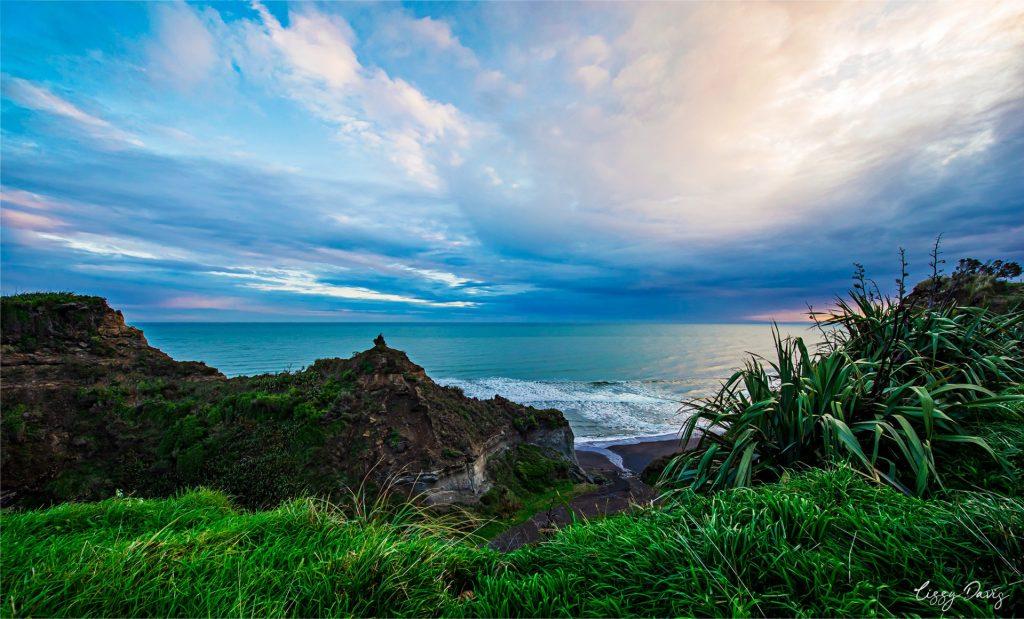 Cloudy sunset over Waihi Beach, Hawera. | NZ travel photos by Lizzy Davis.