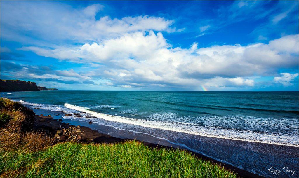 Rainbow over Ohawe Beach. | New Zealand travel photos by Lizzy Davis.