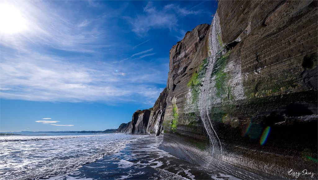 Small waterfall at the White Cliffs, NZ. | Landscape photography by Lizzy Davis.