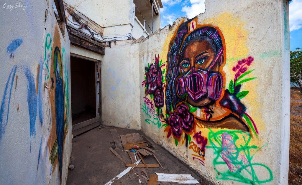Colorful graffiti on abandoned walls of Cunard Paradise Hotel.