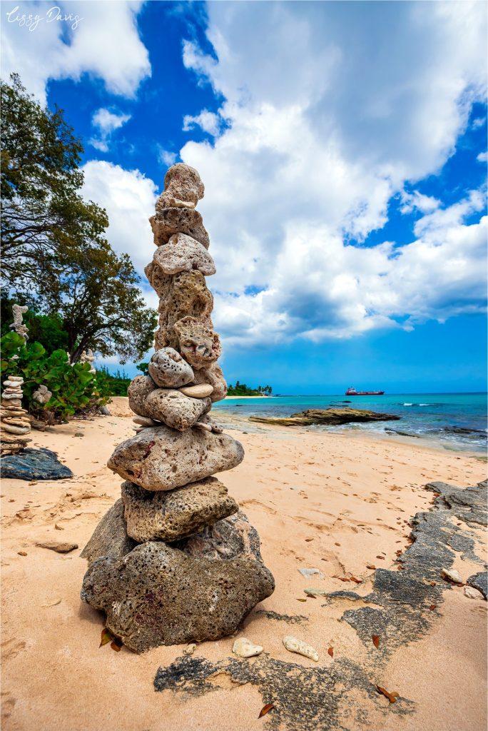 Zen stone statue on beautiful Paradise Beach in Barbados.
