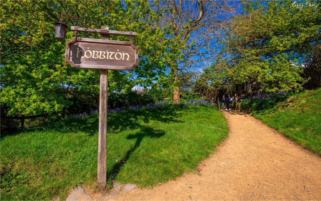 Hobbiton sign pointing toward The Shire at the world famous New Zealand tourist attraction.