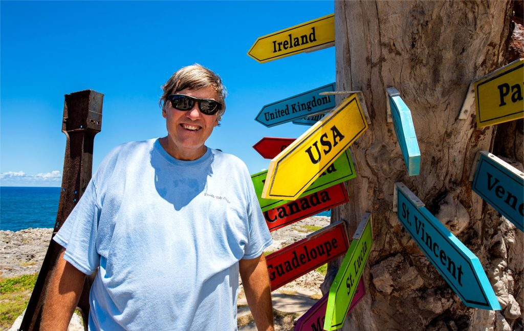 Photo of my dad being a tourist with the fun sign at Animal Flower Cave.