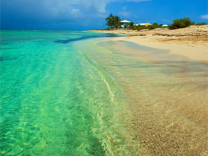 Crystal clear turquoise Caribbean water at Grand Turk in the Turks and Caicos Islands. Beach photography by Lizzy Davis.