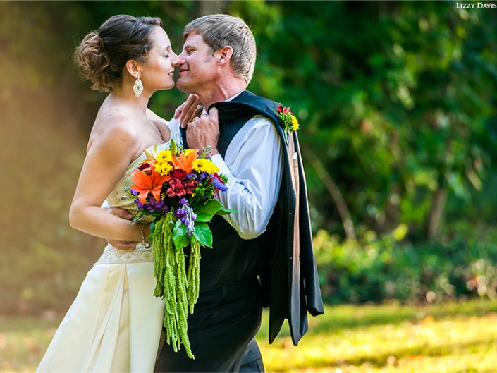 Newlyweds close in for a kiss. Wedding photographer Lizzy Davis in Sanford, NC.