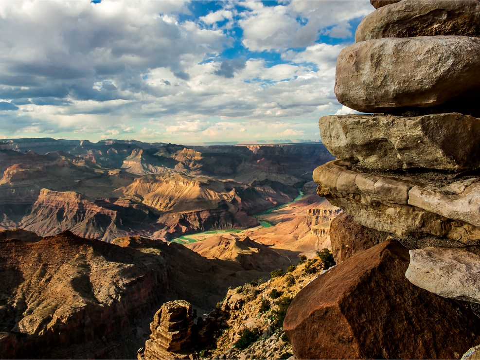 Spectacular view of the Colorado River running through the Grand Canyon. Landscape photography by Lizzy Davis.