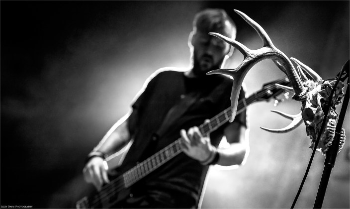 Black & White photograph of a skull hanging from hard rock band Seether's microphone stand at Rockstar Uproar 2014.