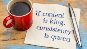 Image of coffee mug on paper that says if content is kind, consistency is queen, blogging and seo