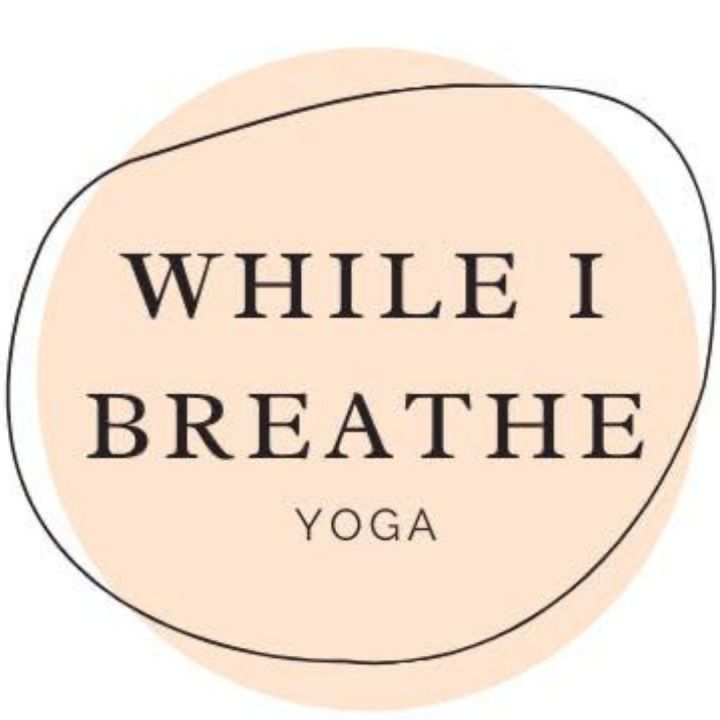 image of while-i-breathe logo black lettering on a pink circle with a black line messily circling