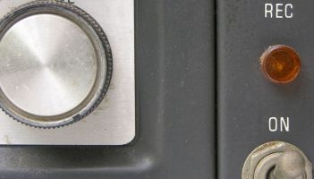 Image of the front of a record player with a botton labelled tone. what is tone of voice?