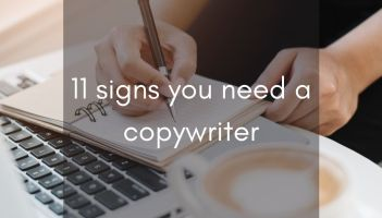 hands at laptop with coffee mug over laid with text 11 signs you need a copywriter