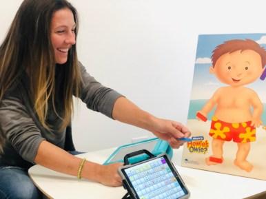 Jeni Bakula demonstrating augmentative and alternative communication device usage